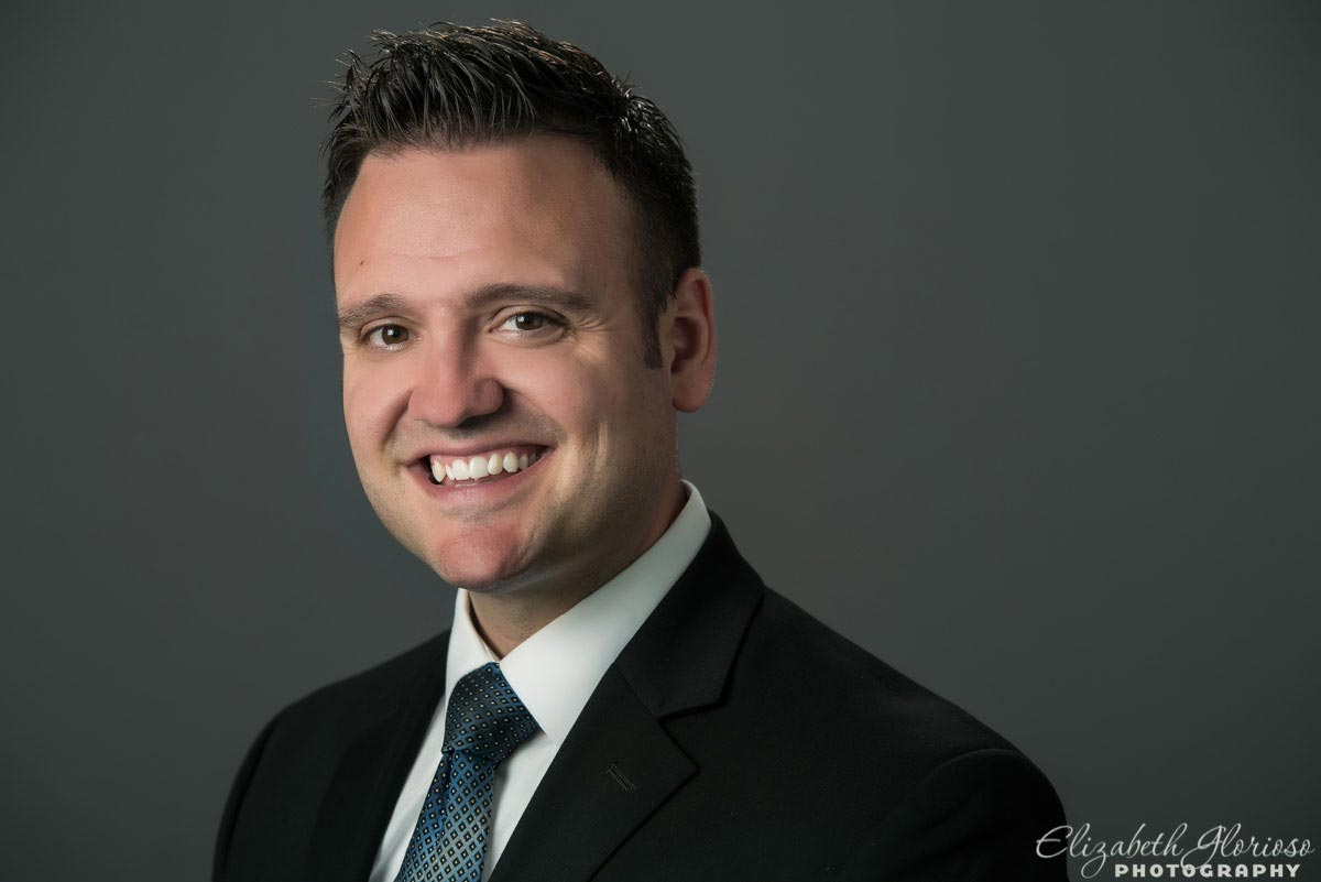 Business headshot on a gray studio background in Cleveland, Ohio
