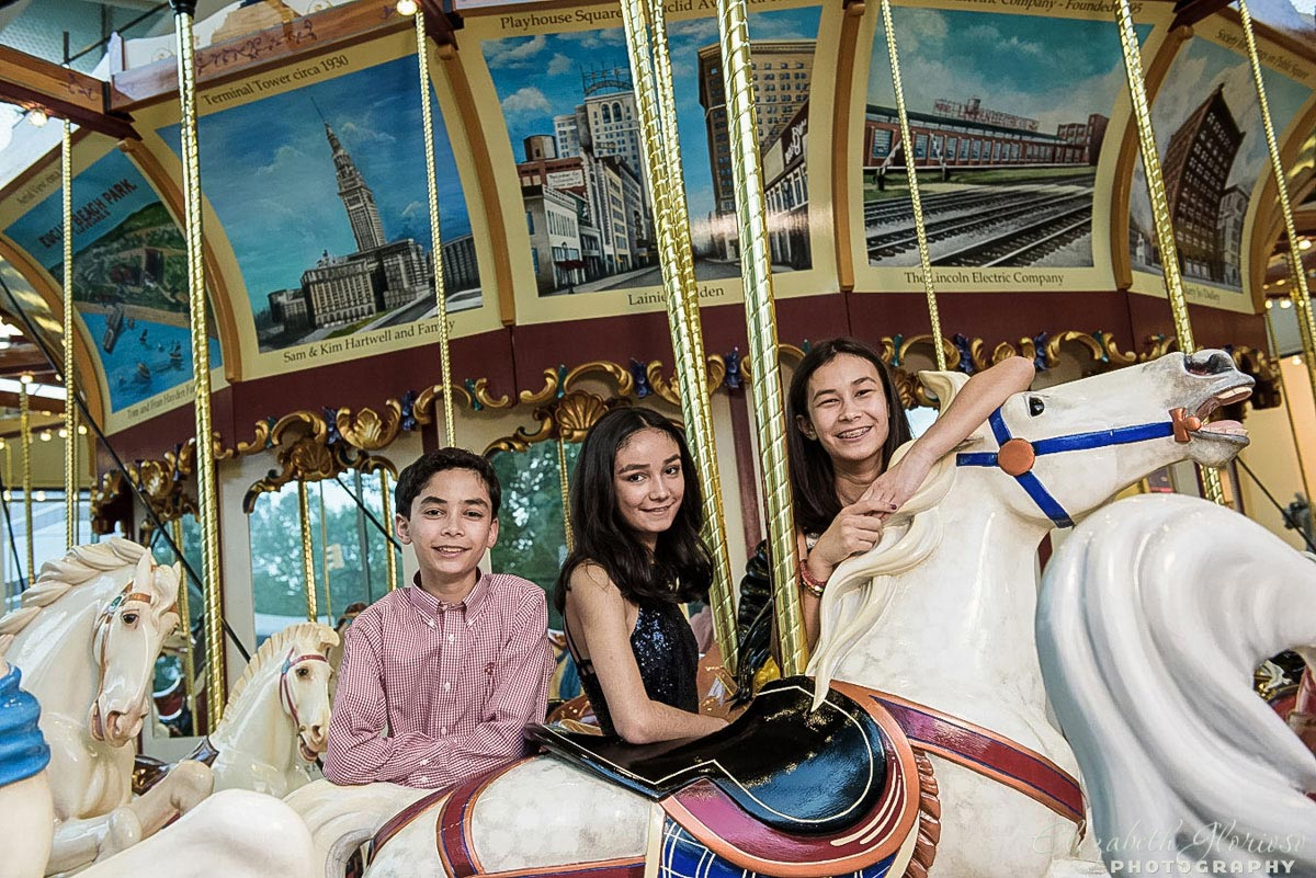 B'nai Mitzvah family portrait on Euclid Carousel at the Cleveland Historical Society
