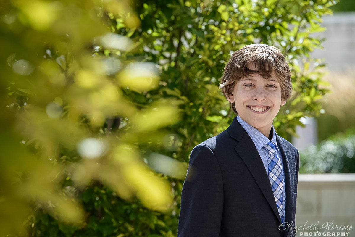 Bar Mitzvah boy portrait in outdoor courtyard Fairmount Temple Beachwood, Ohio