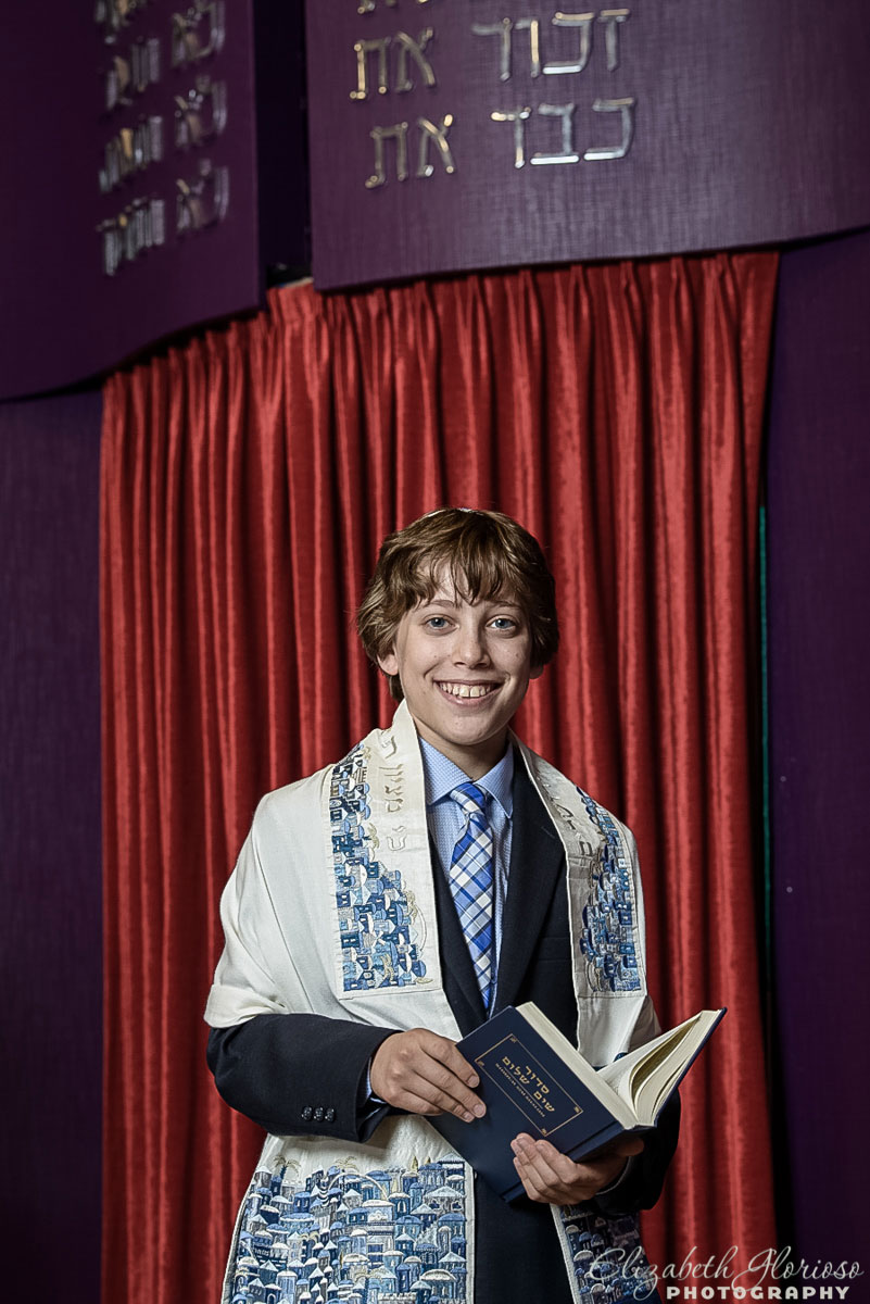 Bar Mitzvah boy with a prayer book in the chapel at B'nai Jeshurun in Pepper Pike, Ohio
