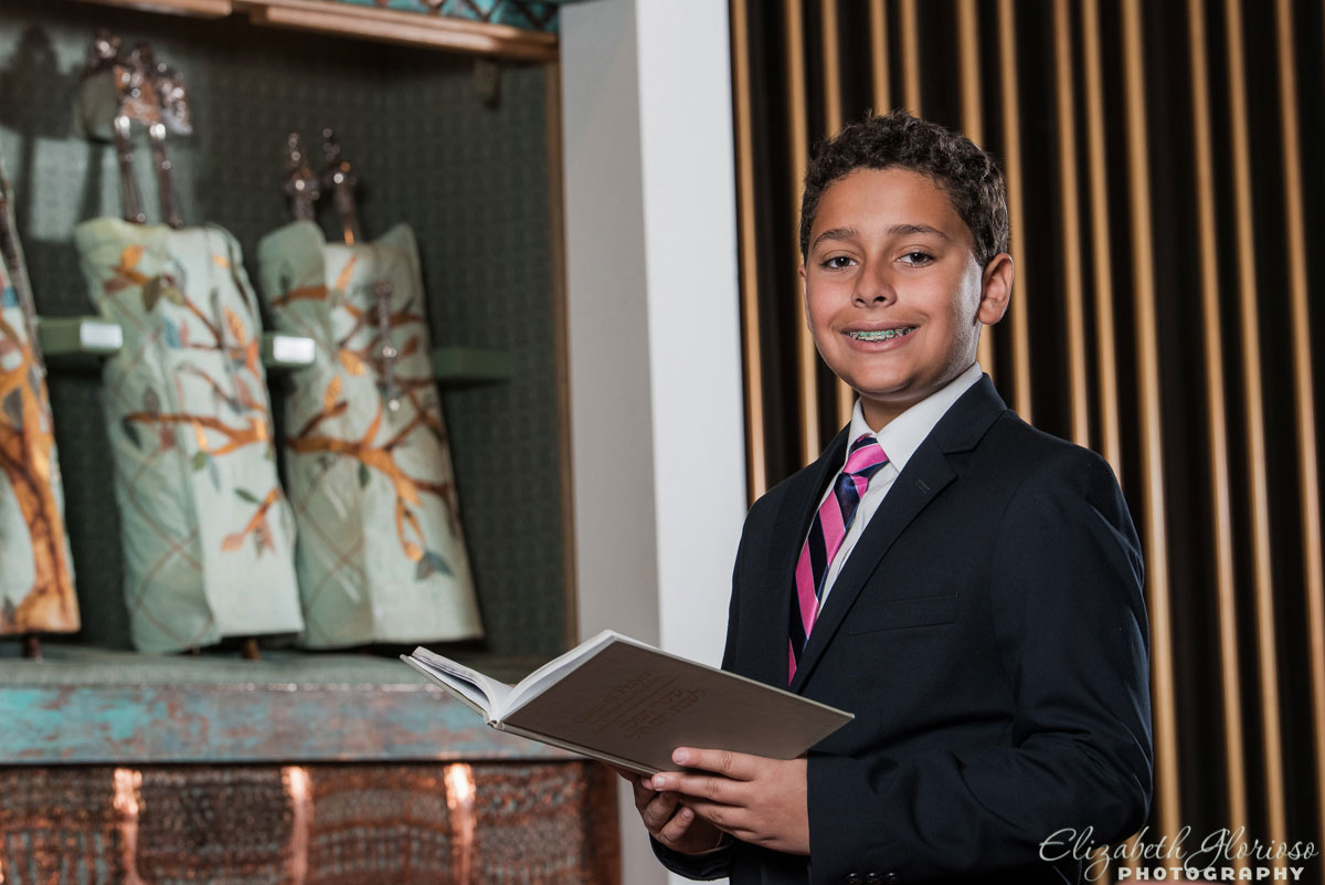 Bar Mitzvah boy with prayer book at Suburban Temple Shaker Heights, Ohio