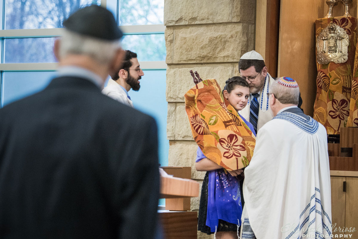 Mitzvah girl holding the Torah during her service at Temple Emanu El Orange Village, Ohio