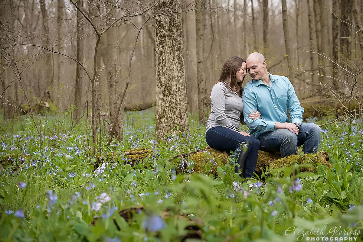 Engaged couple with spring flowers in Burton Ohio