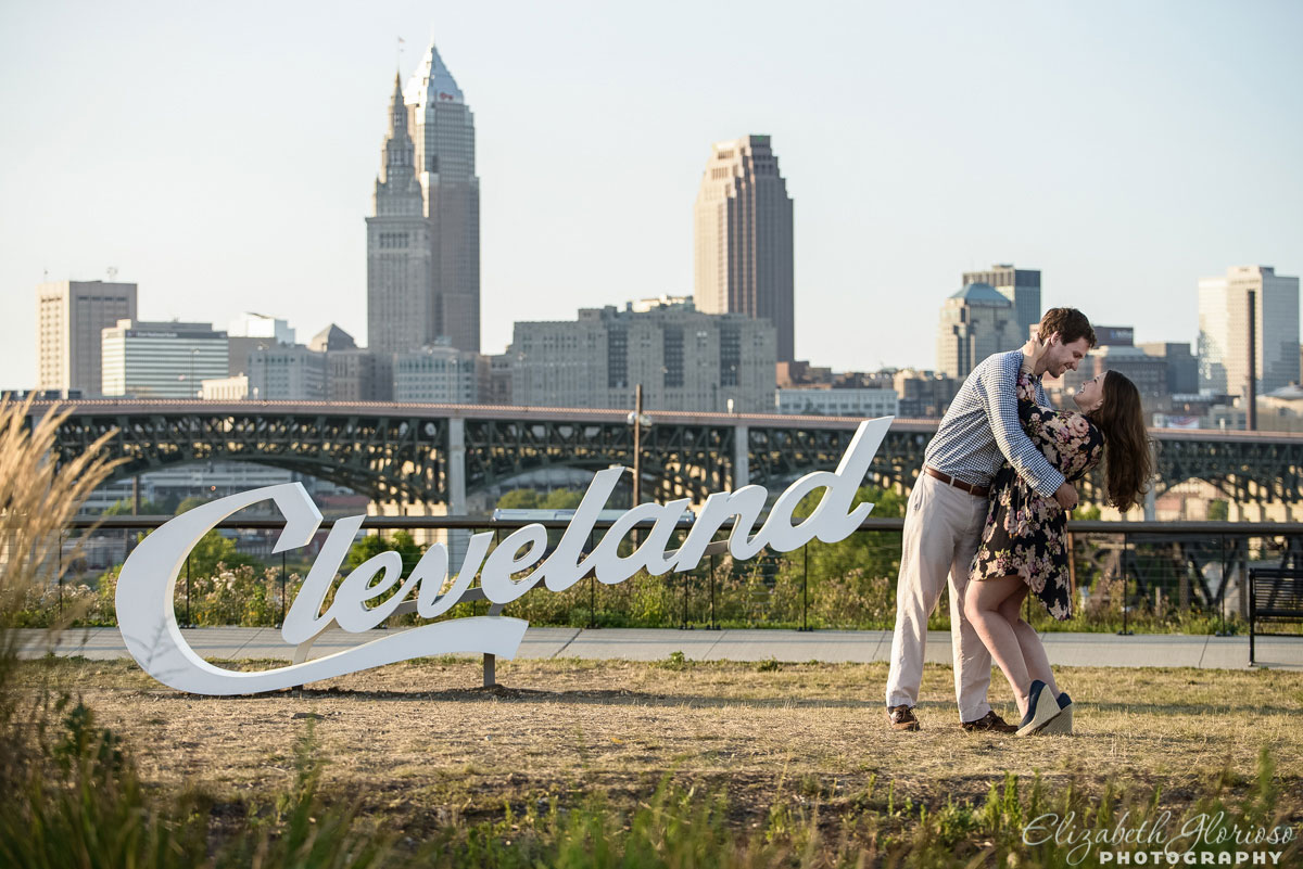 Summer engagement session by the Cleveland sign in Tremont Cleveland Ohio