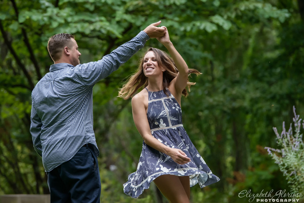 Couple dancing at their engagement session at Cleveland Cultural Gardens in Cleveland Ohio