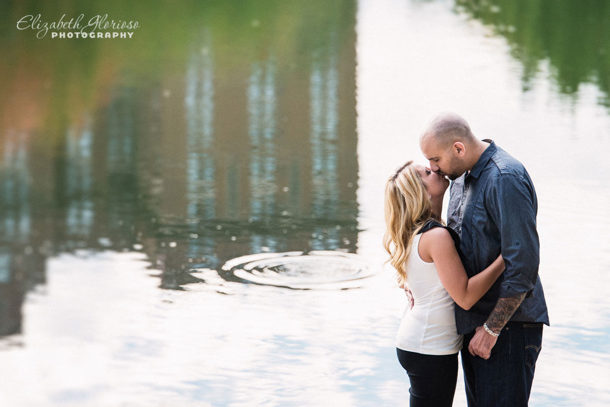 Couple embraces at the Cleveland Museum of Art lagoon in Cleveland Ohio