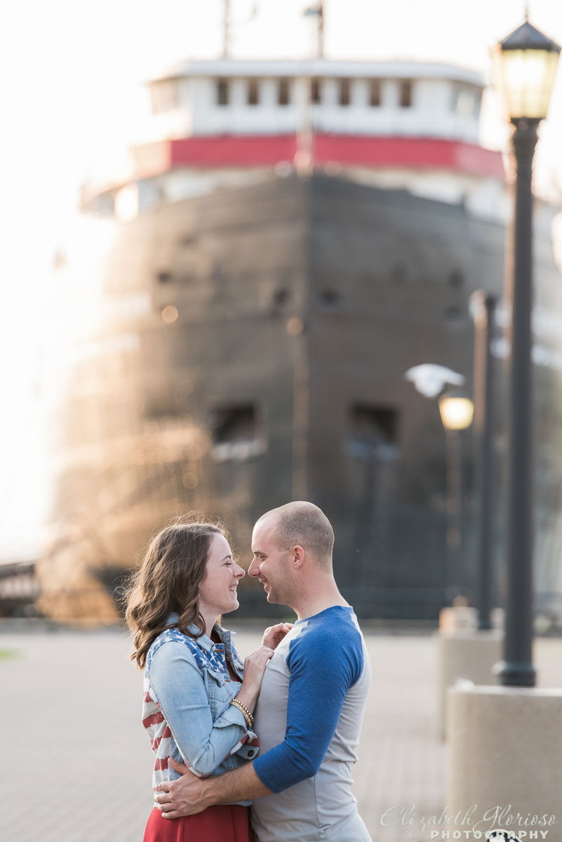 Couple snuggling at the Mather ship at East 9th Pier in Cleveland Ohio