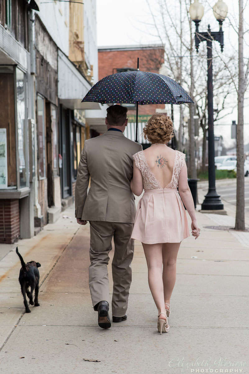 Engagement in the rain under an umbrella with their little dog in Ravenna, Ohio