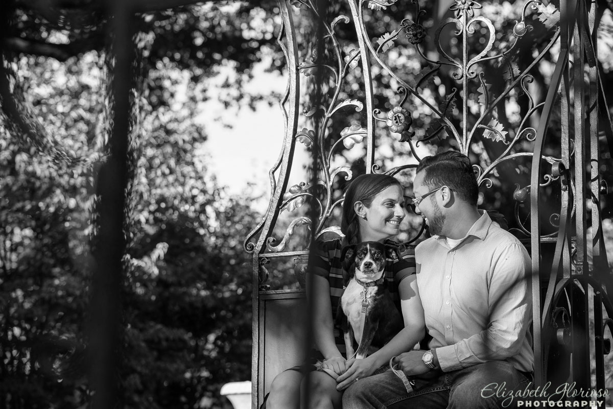 Couple at their engagement session with their little dog at Cleveland Cultural Gardens in Cleveland Ohio
