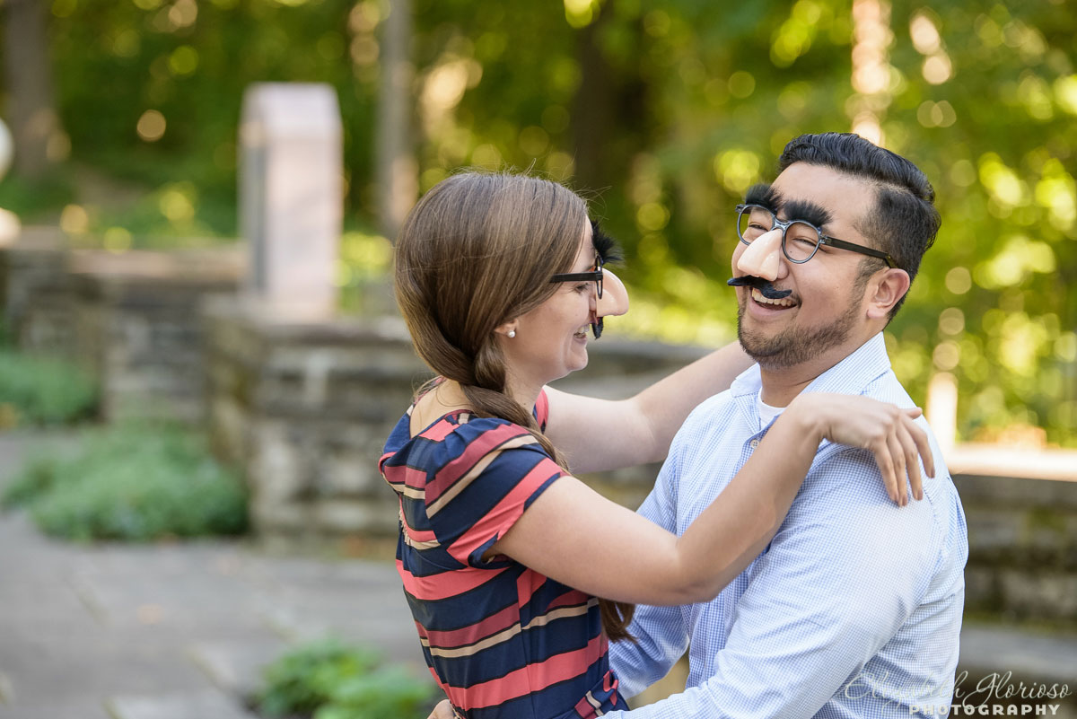Couple at their funny engagement session at Cleveland Cultural Gardens in Cleveland Ohio