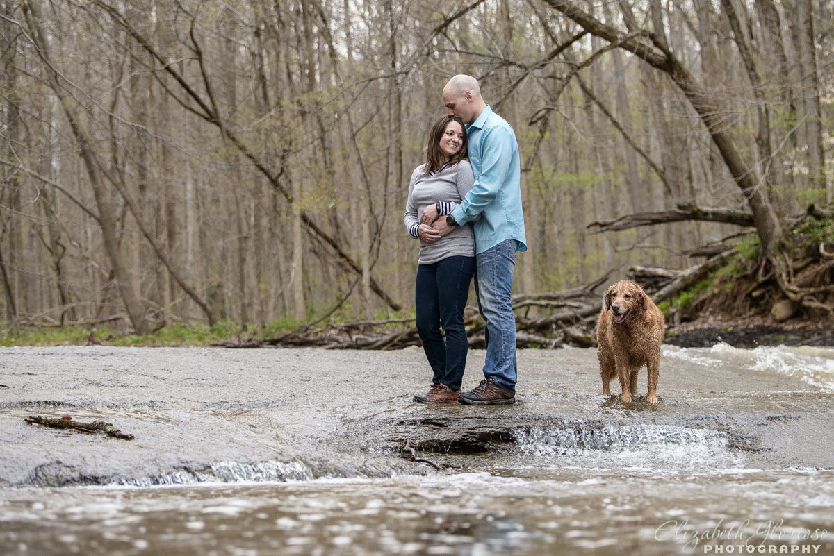 Engaged couple with golden retriever dog in Burton Ohio