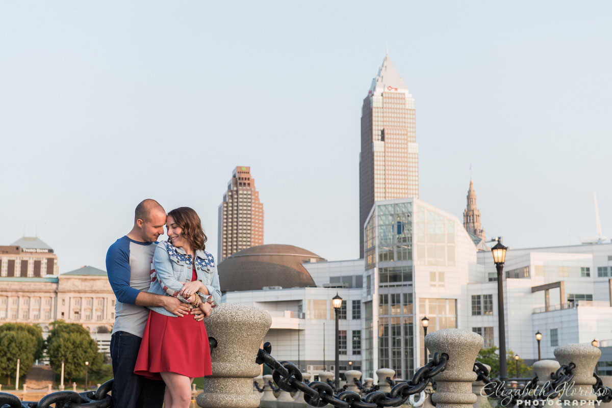 Engagement session on East 9th Street pier with Cleveland skyline in Cleveland, Ohio