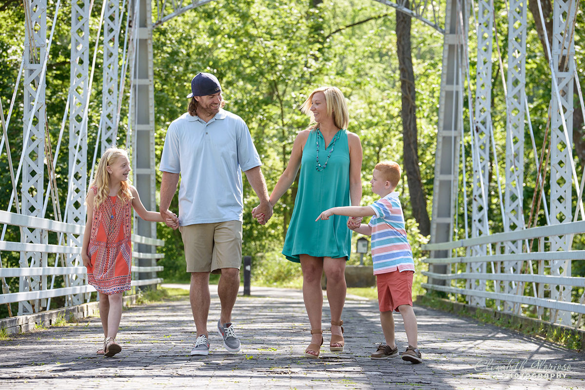 Lifestyle family portrait Brecksville Metropark bridge
