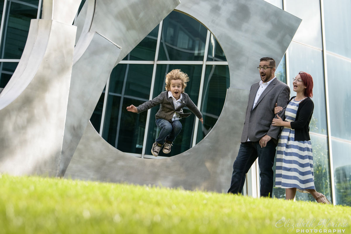 Outdoor family portrait with mother, father and young son at the Aerospace Institute in Cleveland, OH