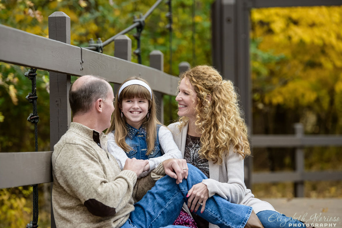 Family portrait session with smiling dad, mom and daughter at the Cleveland Metroparks