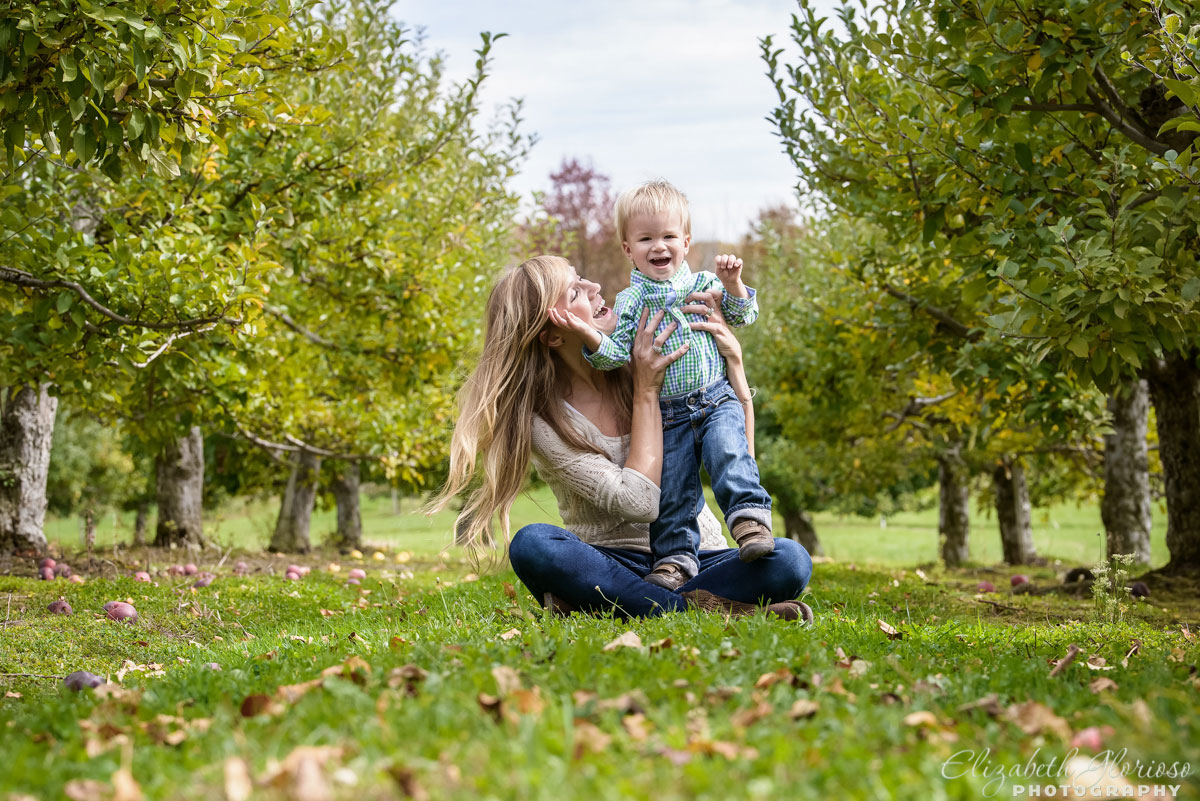 Family portrait session with happy mother and baby at Royalton Farm in North Royalton, Ohio