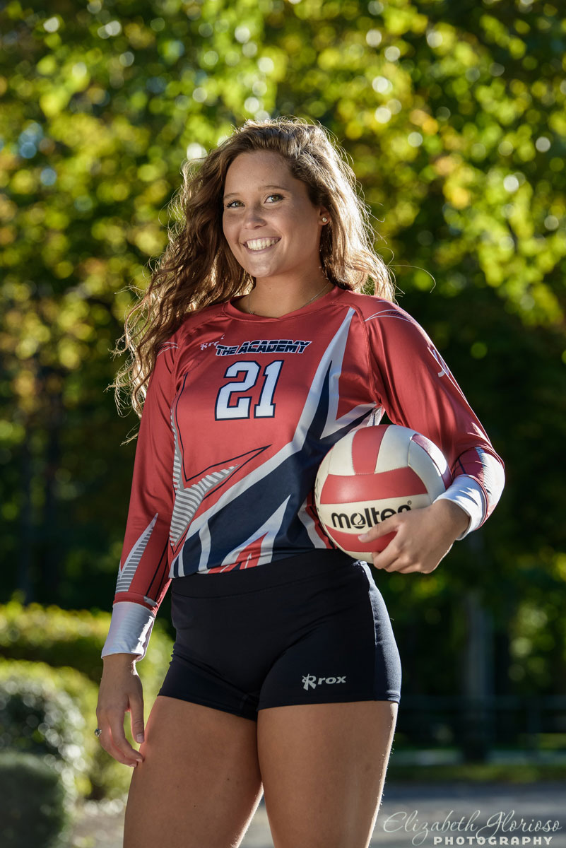 Portrait of high school senior girl in her volleyball gear at Huntington Beach, part of the Cleveland Metroparks, in Bay Village, OH
