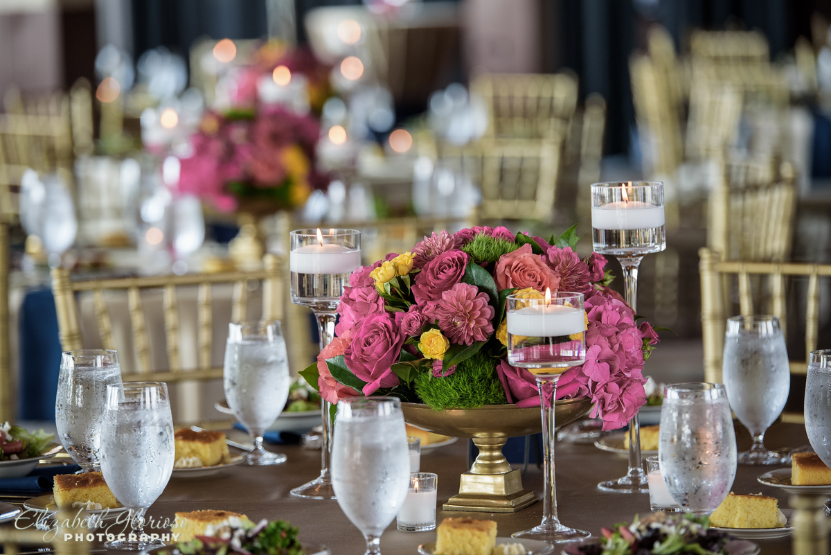 Pink floral centerpieces for reception at Ariel international Cleveland Ohio
