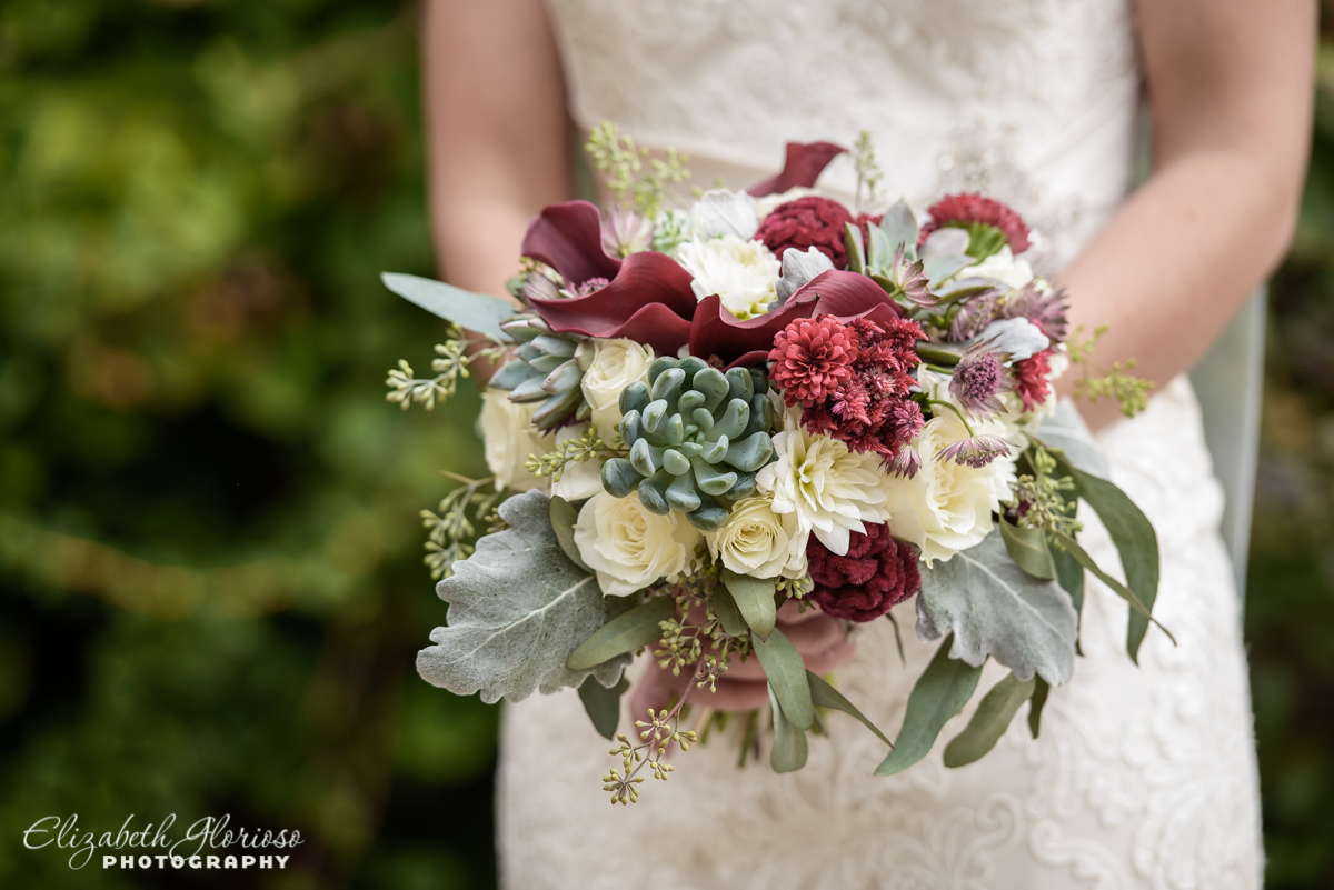 Bridal bouquet with white and red roses, succulents and lamb's ears at Cleveland Botanical garden