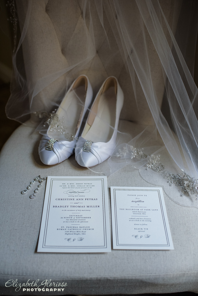 Bride shoes and wedding invitation at the Ballroom at Parklane Cleveland Ohio