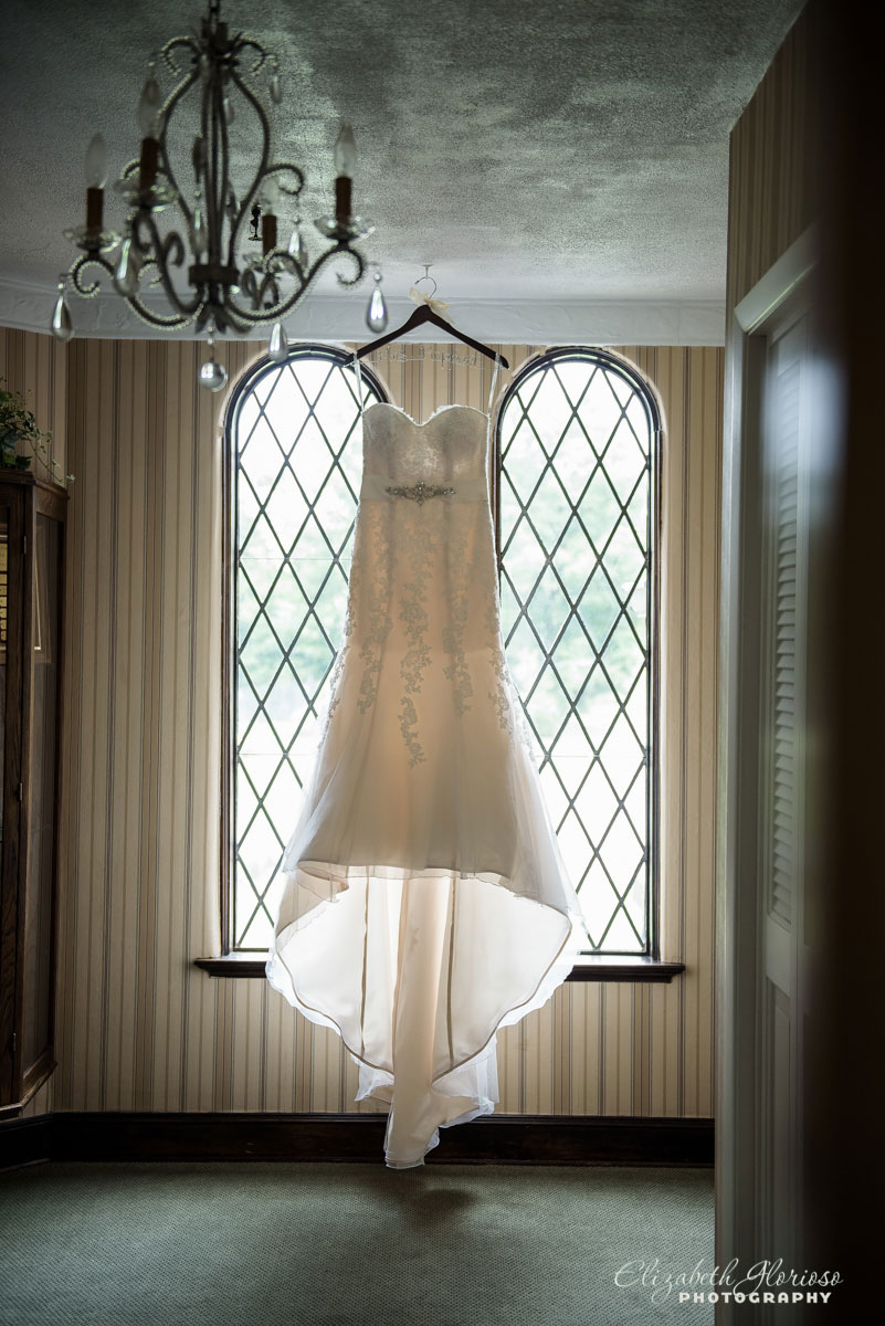 Picture of wedding dress in front of window
