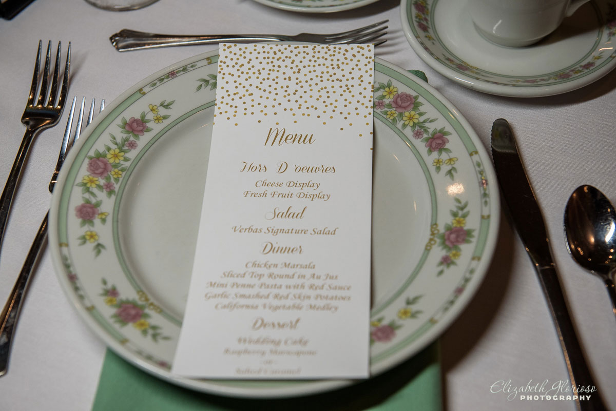 Photo of plate and menu at wedding reception