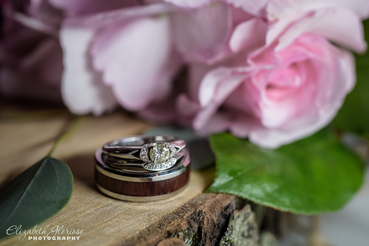 Wedding rings with wood inlay and pink roses Mapleside Farm barn Cleveland Ohio