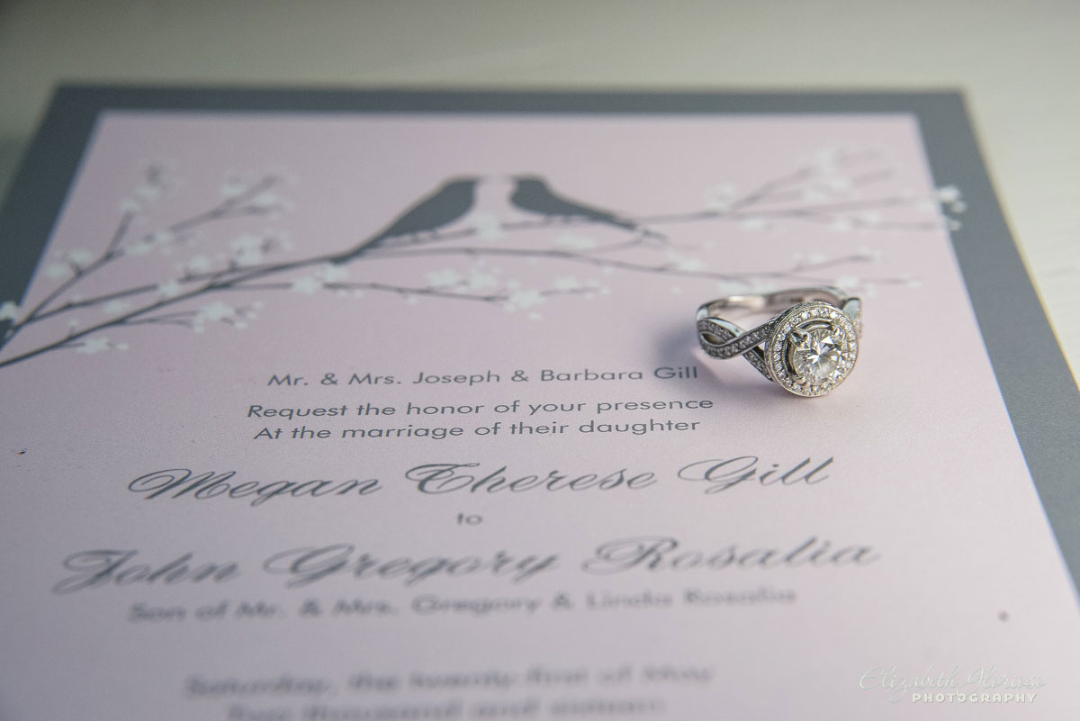 Photo of invitation and wedding rings