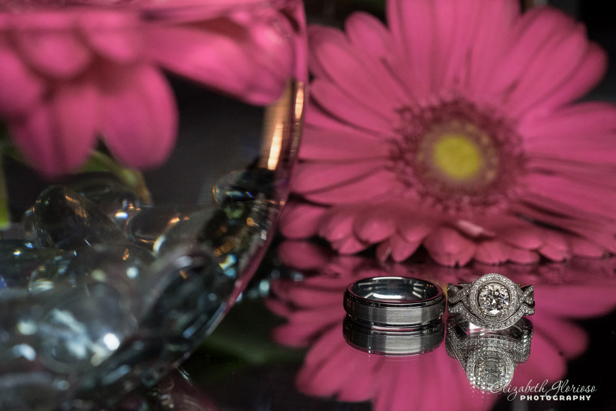 Photo of wedding rings near flowers