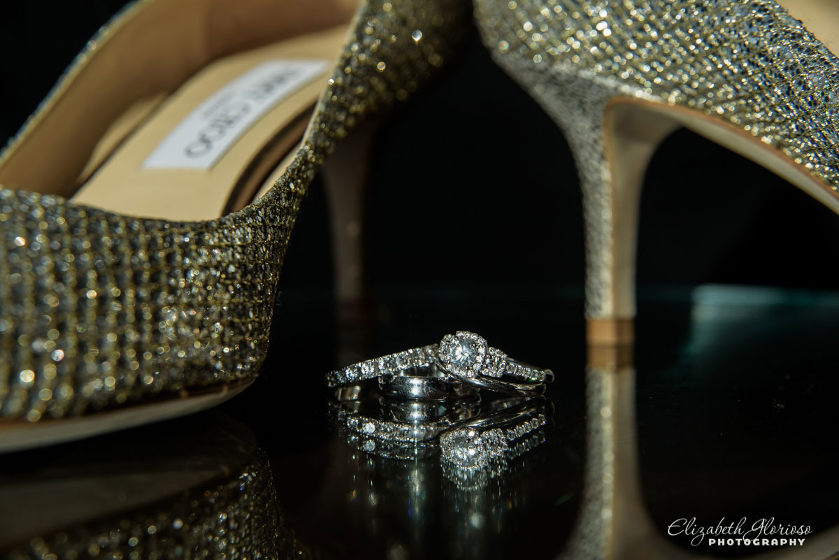 Picture of wedding rings and bride's shoes