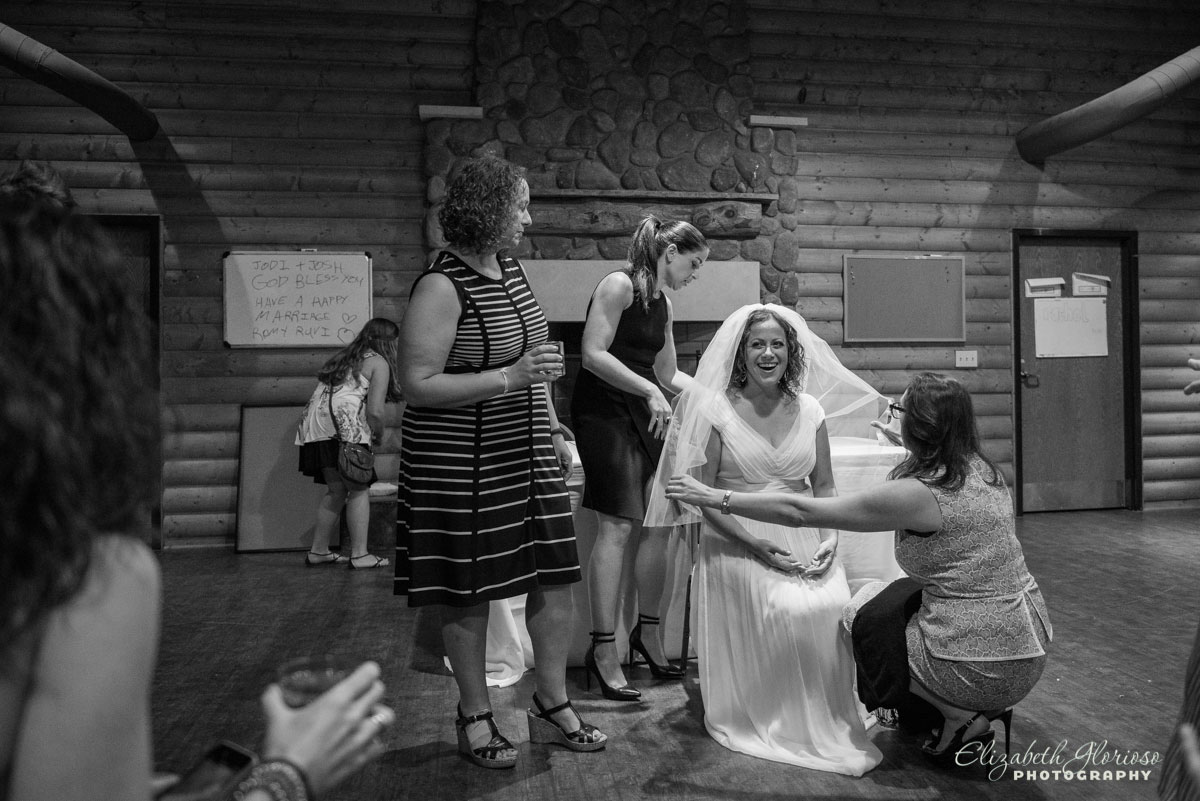 Wedding photo of bride and guests taken at Camp Wise in Chardon, OH