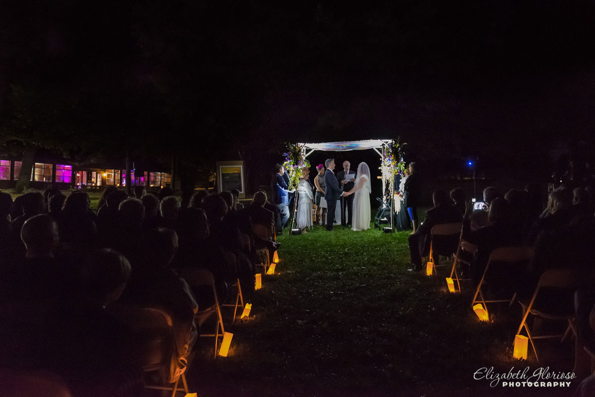 Photo of nighttime wedding ceremony at Camp Wise in Chardon, OH