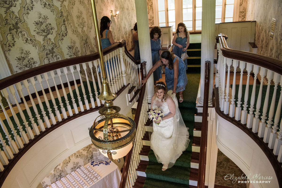 Wedding photo of bridal party coming down the stairs at Mooreland Mansion in Kirkland, Ohio