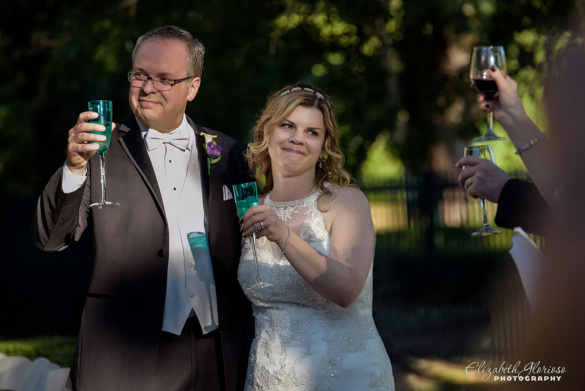Wedding photograph of bride and groom toasting at Mooreland Mansion in Kirkland, Ohio