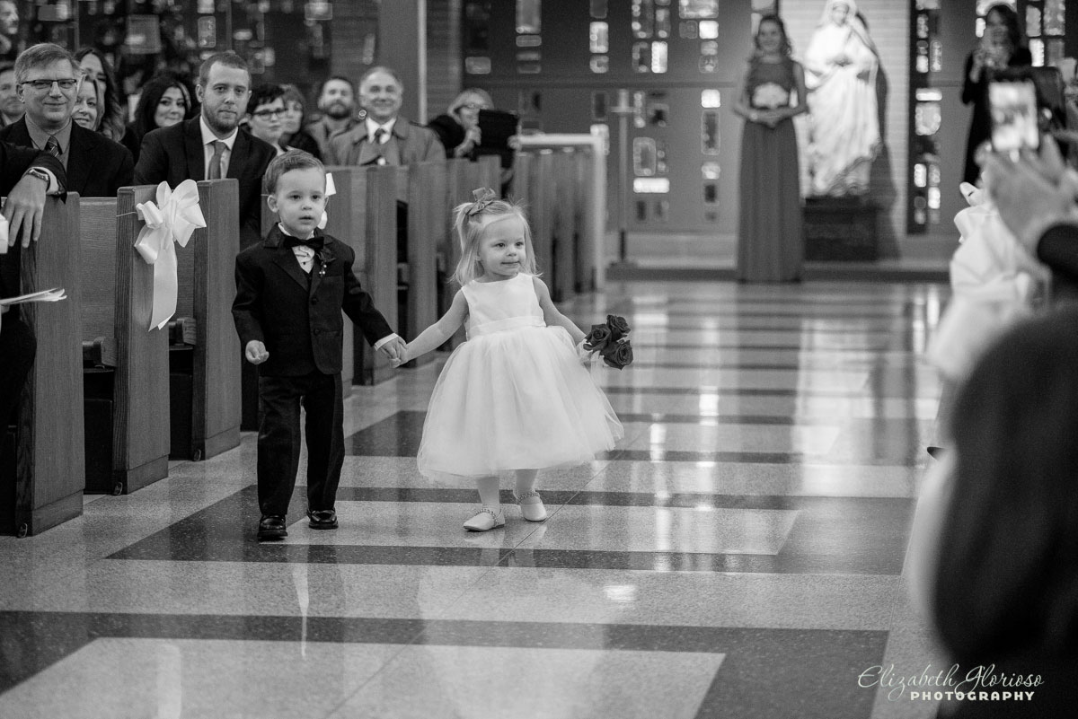 Photo ring bearer and flower girl at wedding ceremony at St. John Cantius in Cleveland, OH