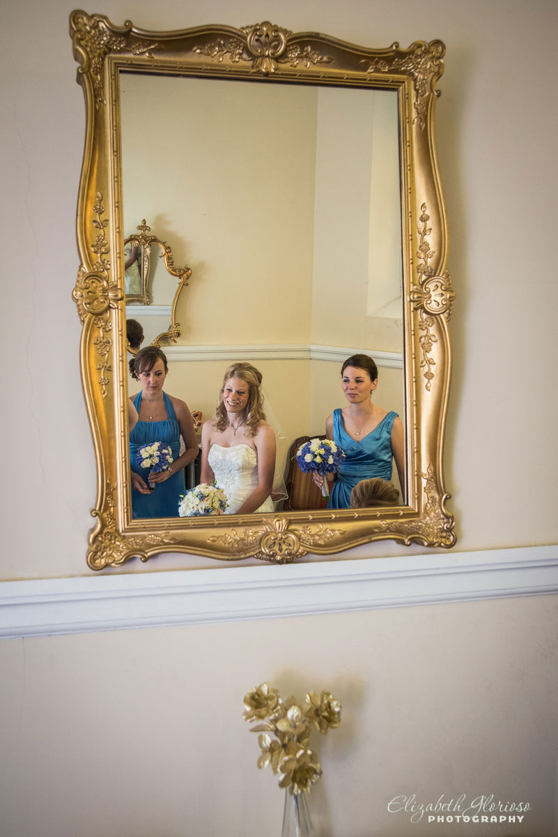 Photo of bride and bridesmaids taken in front of a mirror at St. John Cantius in Cleveland, OH