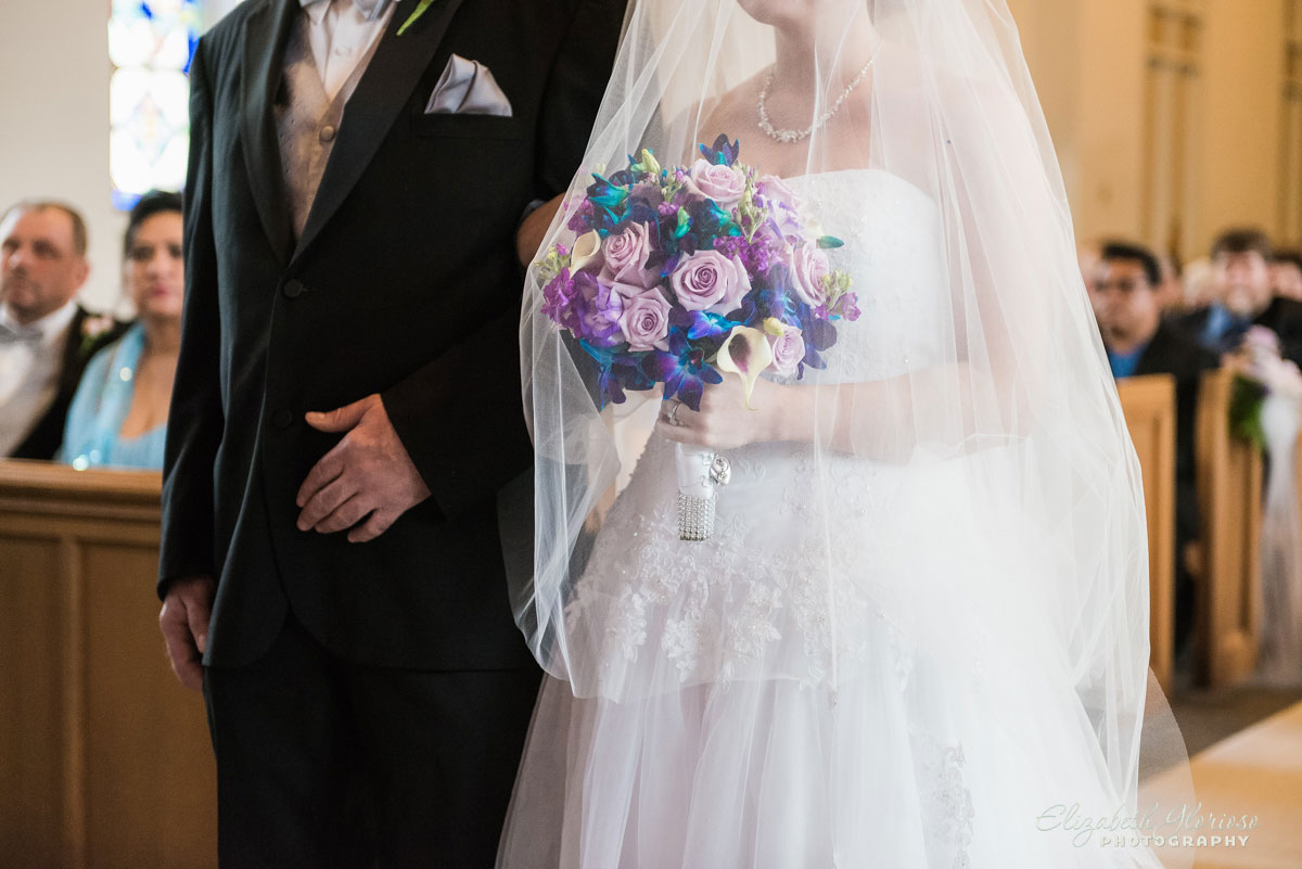 Photo of bride and father walking down the aisle at Christ United Methodist Church in Cleveland, OH