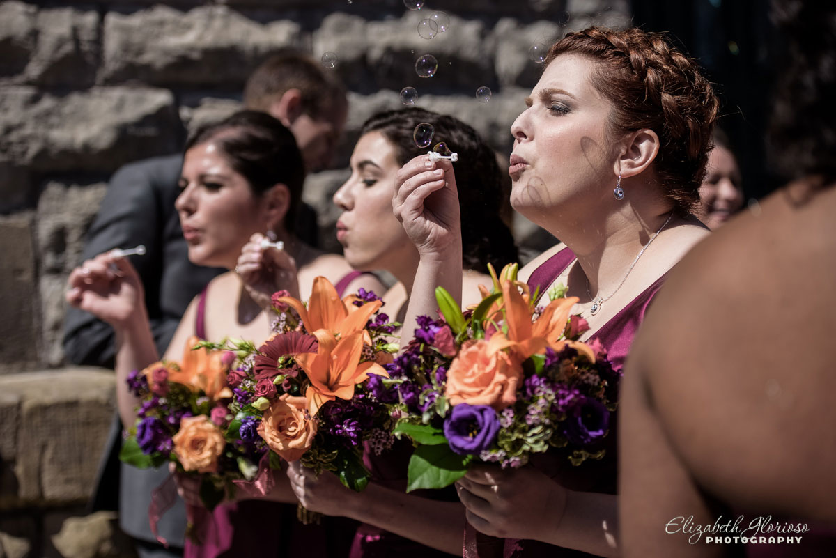Photo of bridal party blowing bubbles