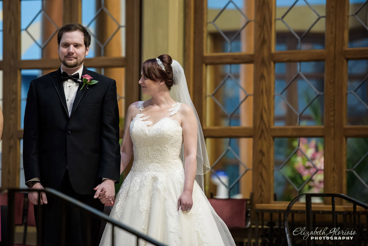 Picture of bride and groom taken at the Our Lady of Angels Church in Rocky River, OH