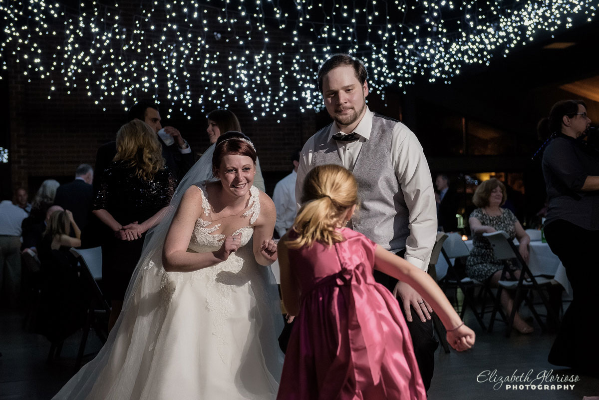 Wedding photo of bride, groom and flower girl taken at St. Clarence Pavilion in North Olmsted, OH