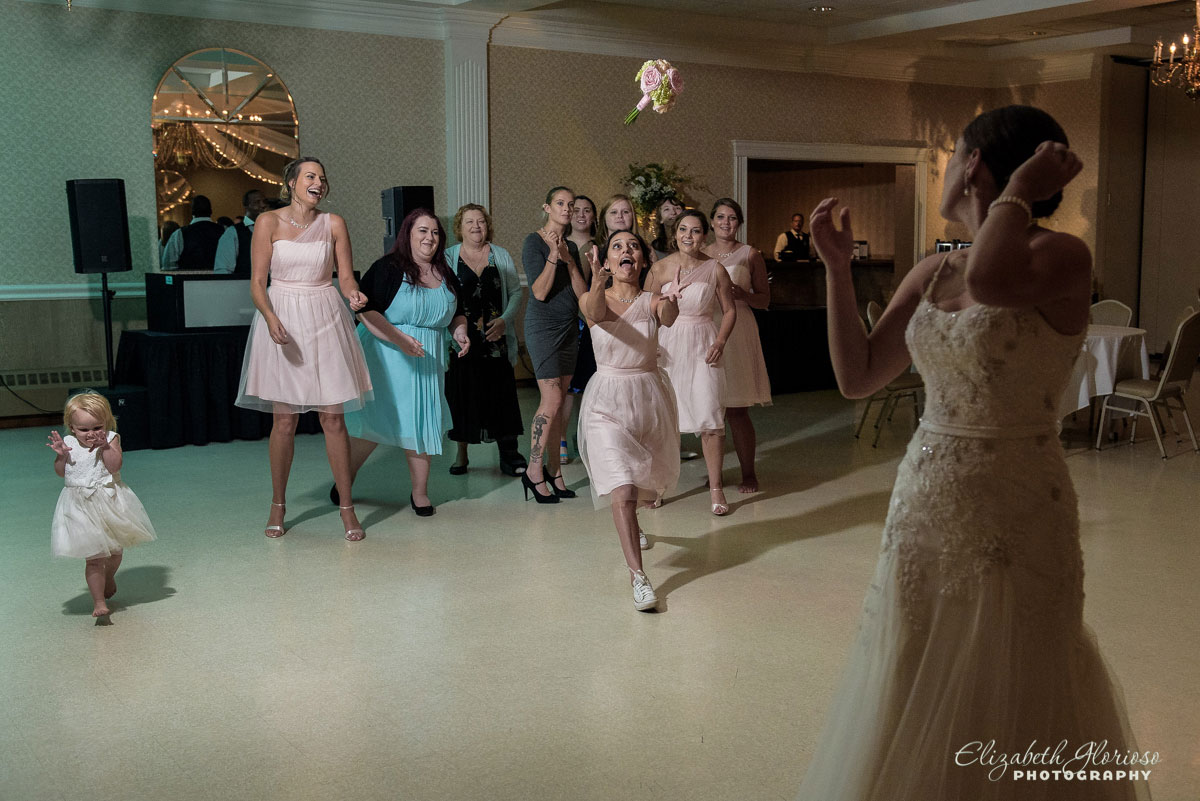 Picture of bouquet toss at wedding reception at Tom's Country Place Avon