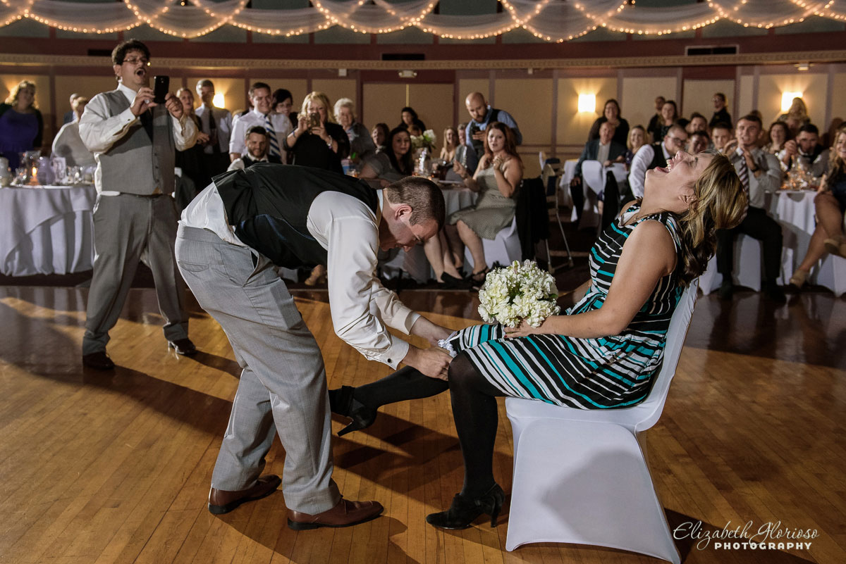 Photo of groom removing bride's garter taken at the Astrodome of Parma, OH