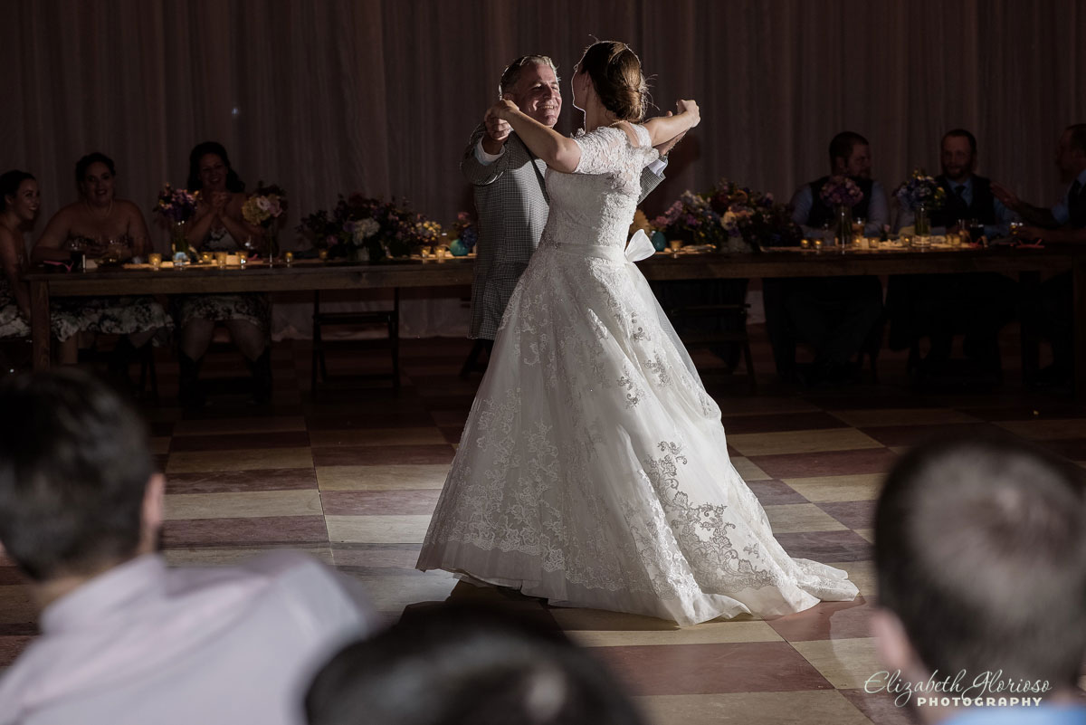 Photo of bride and groom dancing at a barn in Burton, OH