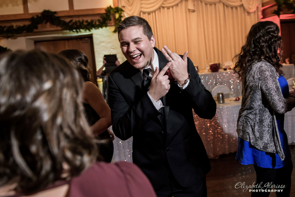 Photo of groom showing off his wedding ring at Carrie Cerino's in North Royalton, OH