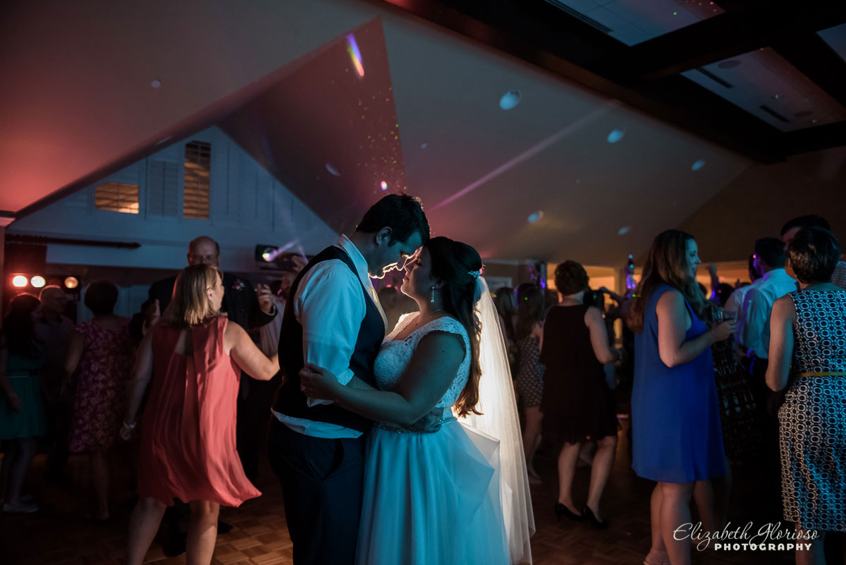 Photo of bride and groom dancing at wedding reception in Westfield Group Country Club in Westfield Center, OH