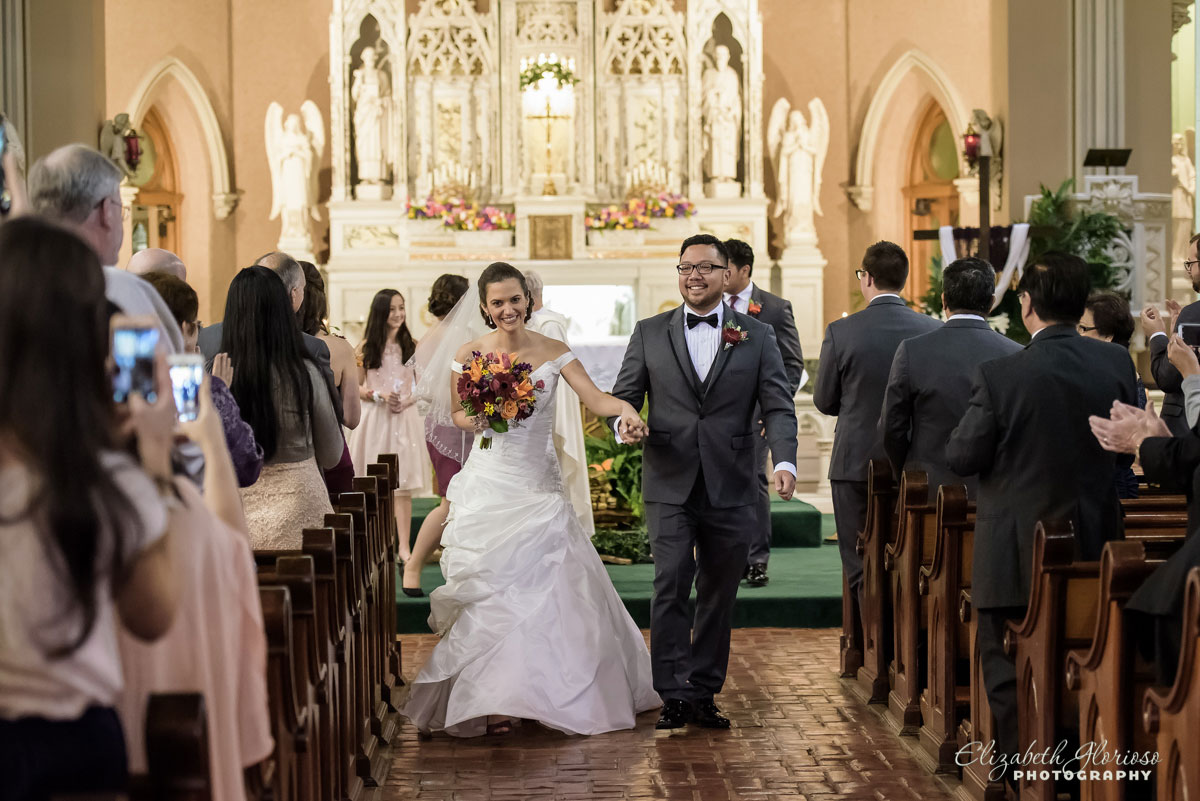 Photo of bride and groom at wedding ceremony at St Patrick's in Cleveland, OH