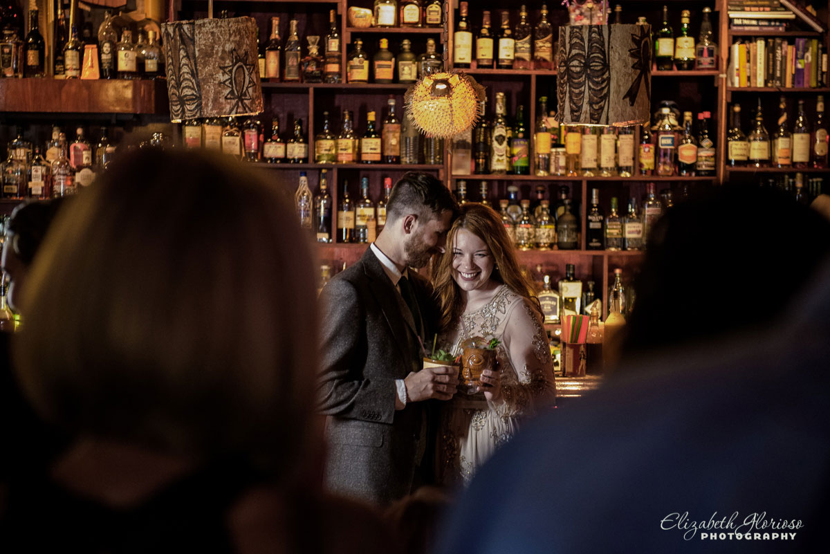 Wedding photo of bride and groom at Porco's Tiki Bar in Cleveland, OH