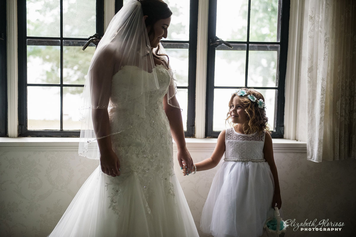 Photo of bride and flower girl at The Tudor House in Akron, OH