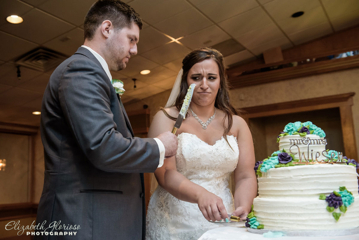 Photo of cake cutting at wedding reception at Guy's Party Center in Akron, OH
