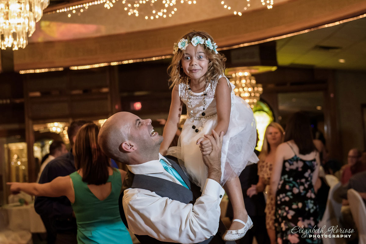 Photo of flower girl and groomsman at a wedding reception at Guy's Party Center in Akron, OH